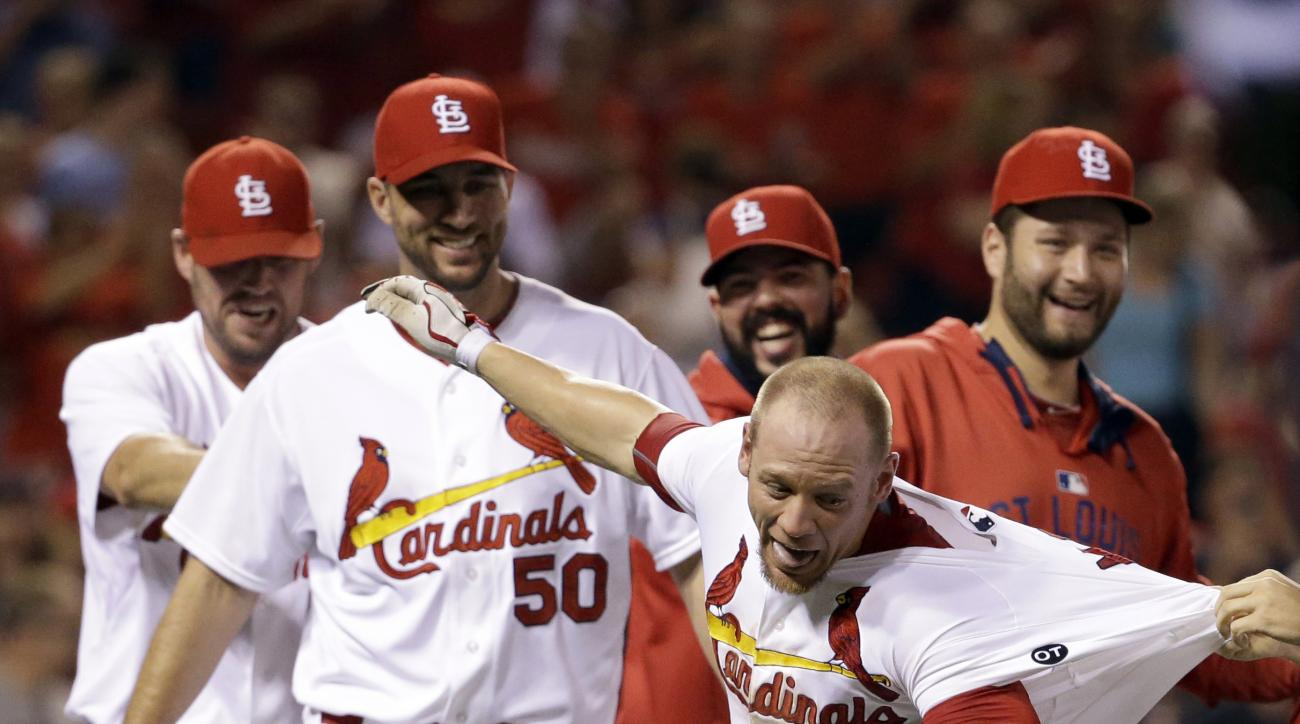 St. Louis Cardinals' Brandon Moss (21) is congratulated by teammates after hitting a walk-off, three run home run to defeat the Washington Nationals 8-5 in a baseball game Tuesday, Sept. 1, 2015, in St. Louis. (AP Photo/Jeff Roberson)