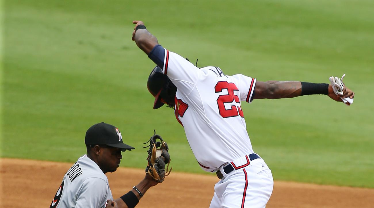 Atlanta Braves' Cameron Maybin avoids the tag by Miami Marlin's Dee Gordon as he advances to second base on a ground ball by Andrelton Simmons during the third inning in a baseball game on Wednesday, Sept. 2, 2015, in Atlanta. Umpires ruled Maybin was out