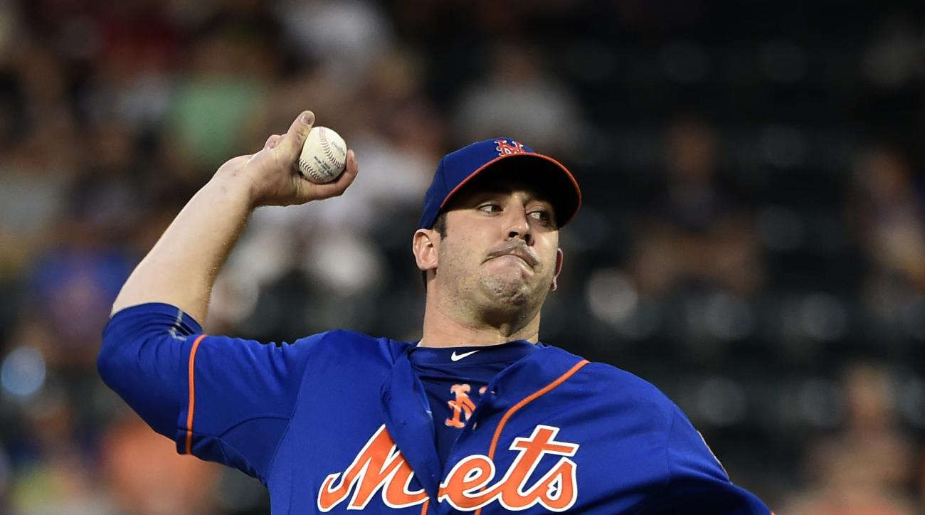 New York Mets starting pitcher Matt Harvey throws against the Philadelphia Phillies during the first inning of a baseball game Wednesday, Sept. 2, 2015, in New York. (AP Photo/Kathy Kmonicek)
