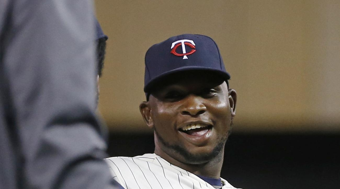 Minnesota Twins' Miguel Sano smiles through the celebration line after the Twins defeated the Chicago White Sox 3-0 in a baseball game, Wednesday, Sept. 2, 2015, in Minneapolis. (AP Photo/Jim Mone)