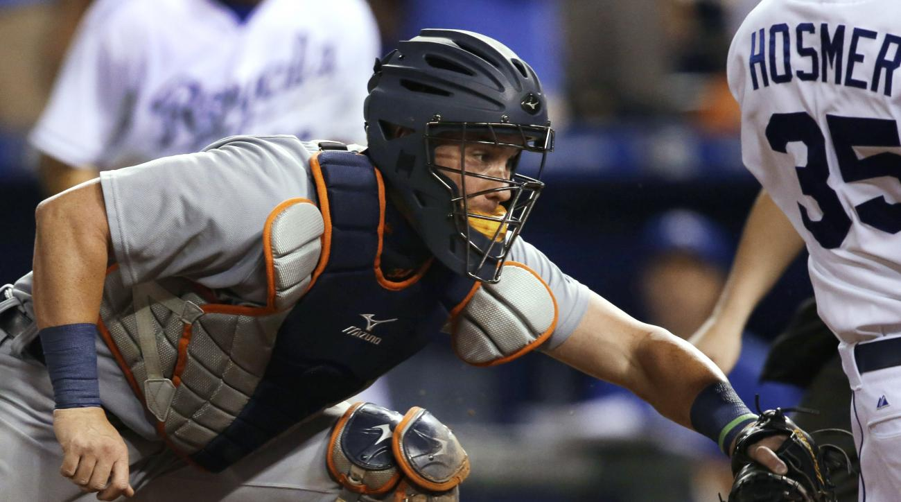 Detroit Tigers catcher James McCann, left, tags out Kansas City Royals' Eric Hosmer during the seventh inning of a baseball game at Kauffman Stadium in Kansas City, Mo., Thursday, Sept. 3, 2015. (AP Photo/Orlin Wagner)