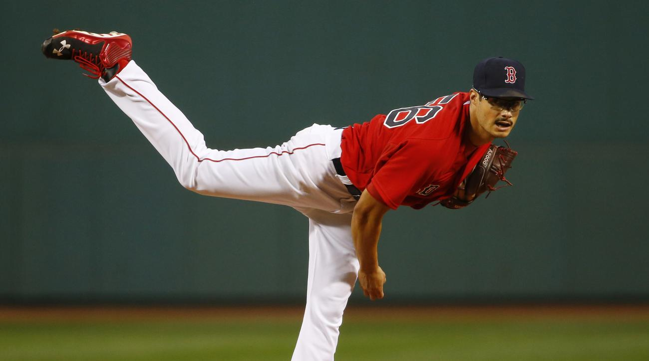Boston Red Sox starting pitcher Joe Kelly delivers against the Philadelphia Phillies during the first inning of a baseball game at Fenway Park in Boston Friday, Sept. 4, 2015. (AP Photo/Winslow Townson)