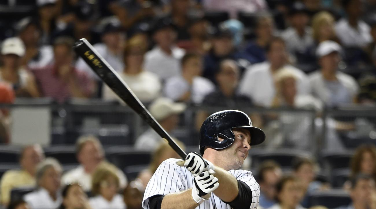 New York Yankees catcher Brian McCann hits a solo home run off of Tampa Bay Rays starting pitcher Jake Odorizzi in the fourth inning of a baseball game at Yankee Stadium on Friday, Sept. 4, 2015, in New York. (AP Photo/Kathy Kmonicek)