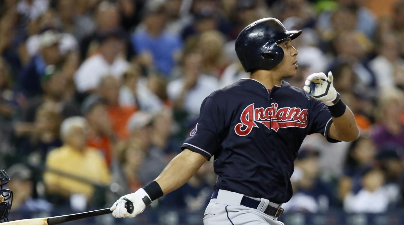 Cleveland Indians' Michael Brantley watches his RBI double against the Detroit Tigers during the fifth inning of a baseball game Friday, Sept. 4, 2015, in Detroit. (AP Photo/Duane Burleson)