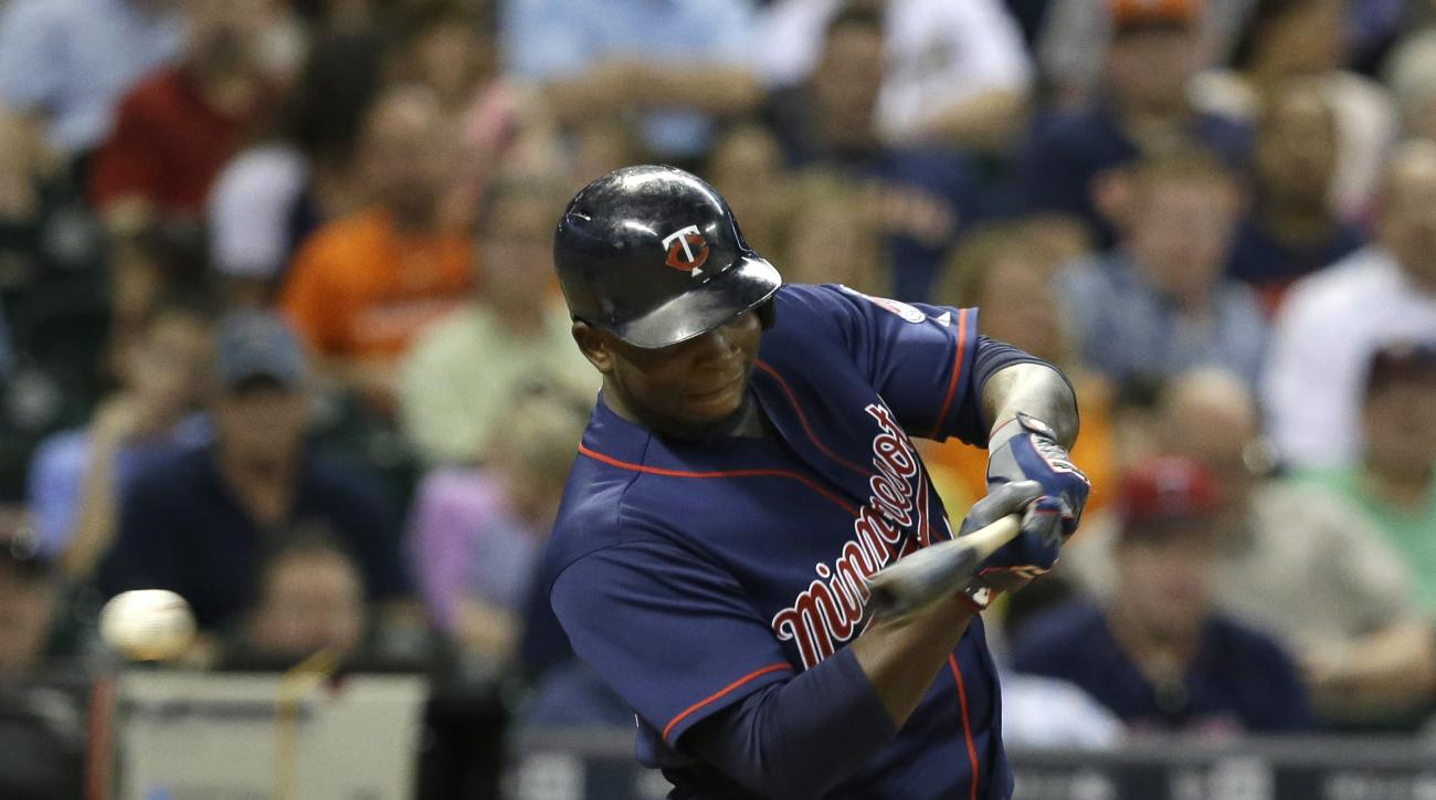 Minnesota Twins' Miguel Sano swings for strike three against the Houston Astros in the sixth inning of a baseball game Friday, Sept. 4, 2015, in Houston. (AP Photo/Pat Sullivan)