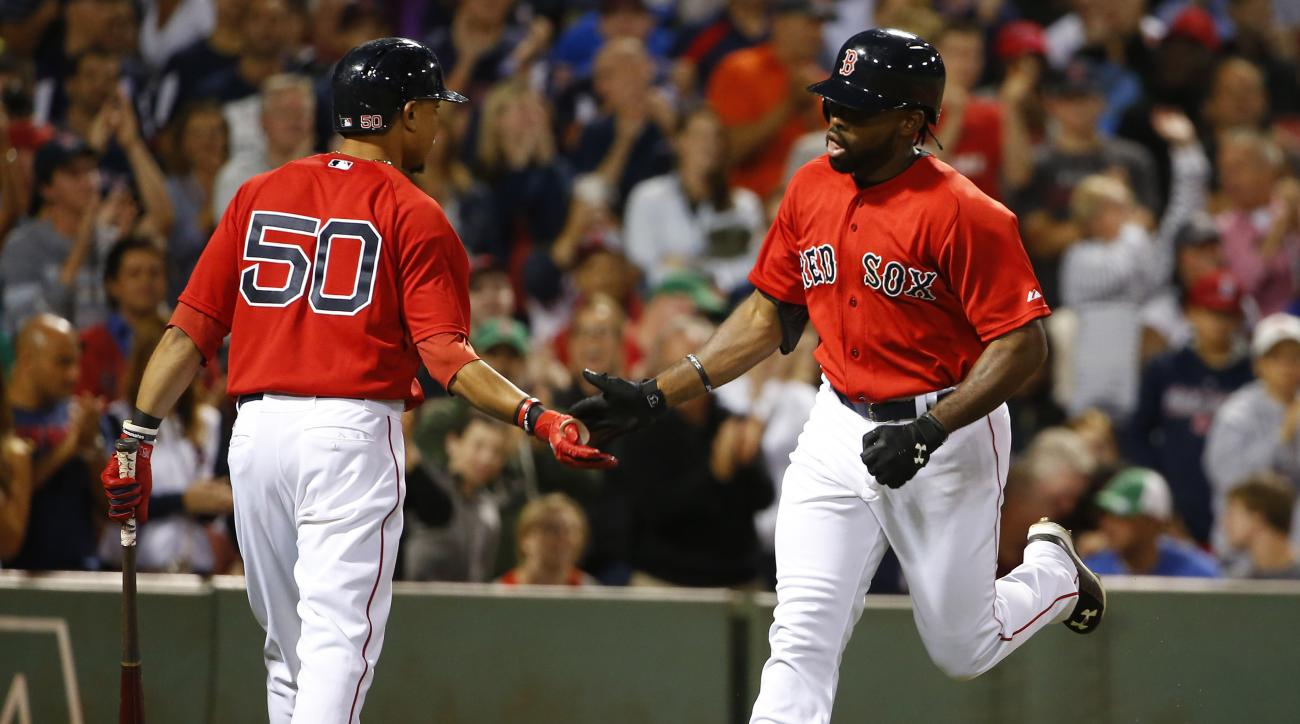 Boston Red Sox's Jackie Bradley Jr. is congratulated by teammate Mookie Betts (50) after his home run against the Philadelphia Phillies during the seventh inning of a baseball game at Fenway Park in Boston Friday, Sept. 4, 2015. (AP Photo/Winslow Townson)