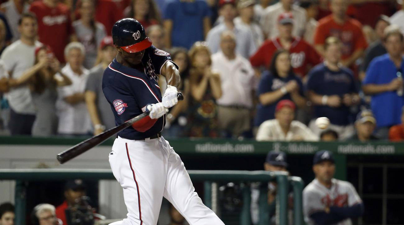 Washington Nationals' Michael Taylor hits a three-run homer to win the game during the 10th inning of a baseball game against the Atlanta Braves at Nationals Park, Friday, Sept. 4, 2015, in Washington. The Nationals won 5-2. (AP Photo/Alex Brandon)