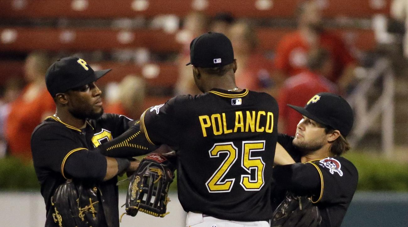 Pittsburgh Pirates, from left, Starling Marte, Gregory Polanco, and Jaff Decker celebrate following the Pirates' 9-3 victory over the St. Louis Cardinals in a baseball game Friday, Sept. 4, 2015, in St. Louis. (AP Photo/Jeff Roberson)