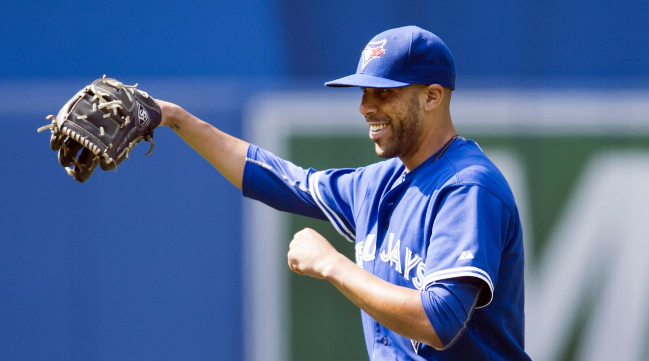 Toronto Blue Jays' starting pitcher David Price laughs after catching a line drive off the bat of Baltimore Orioles' Manny Machado during the sixth inning of a baseball game in Toronto, Saturday, Sept. 5, 2015. (Darren Calabrese/The Canadian Press via AP)