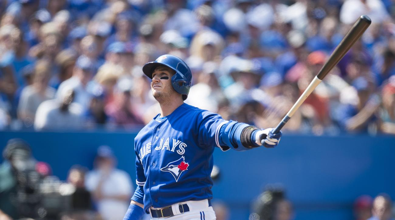 Toronto Blue Jays' Troy Tulowitzki strikes out with the bases loaded during the third inning of a baseball game against the Baltimore Orioles in Toronto, Saturday, Sept. 5, 2015. (Darren Calabrese/The Canadian Press via AP) MANDATORY CREDIT