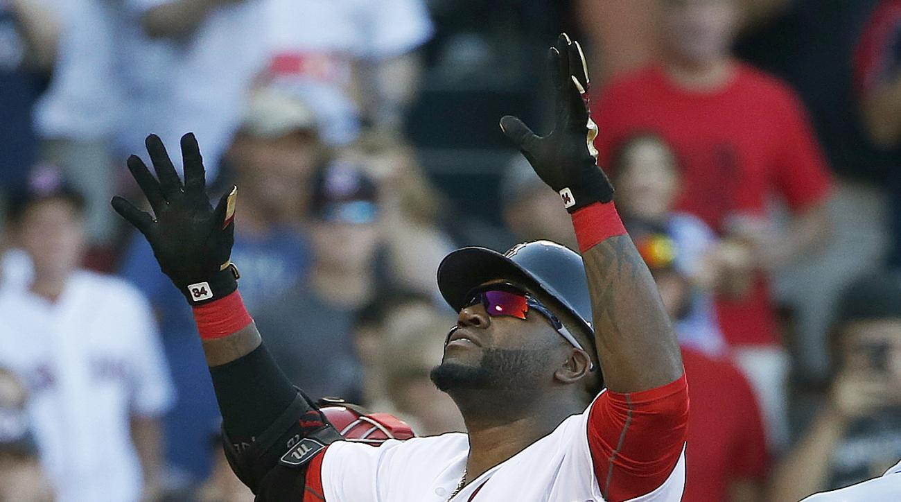 Boston Red Sox's David Ortiz celebrates his solo home run during the fourth inning of a baseball game against the Philadelphia Phillies in Boston, Saturday, Sept. 5, 2015. (AP Photo/Michael Dwyer)