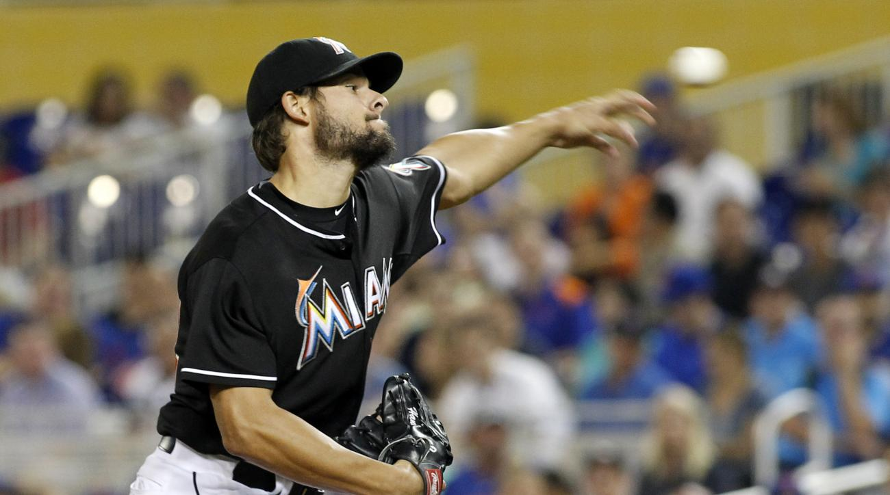 Miami Marlins starting pitcher Brad Hand throws against the New York Mets in the first inning during a baseball game in Miami, Saturday, Sept. 5, 2015. (AP Photo/Joe Skipper)