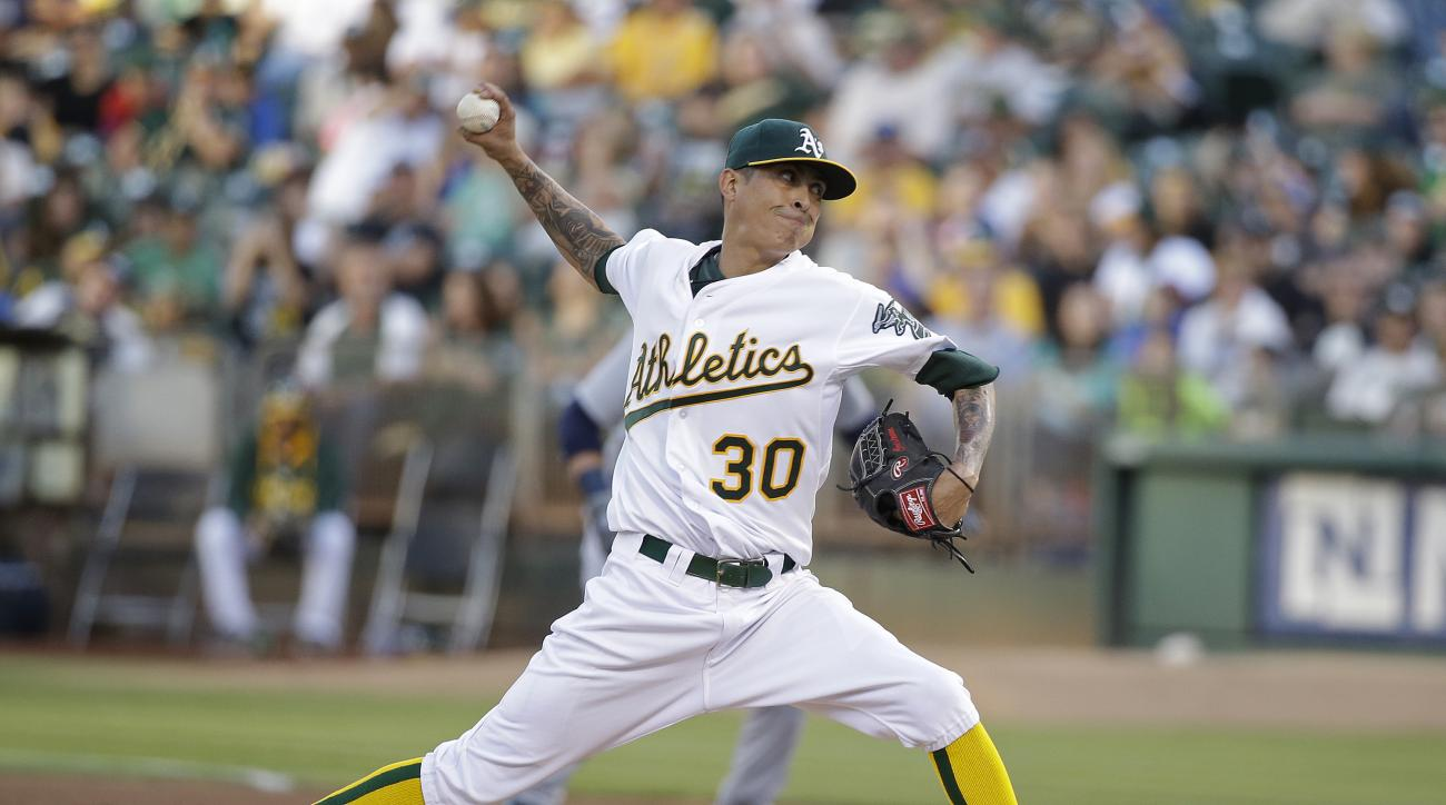 Oakland Athletics starting pitcher Jesse Chavez throws against the Seattle Mariners in the first inning of their baseball game Saturday, Sept. 5, 2015, in Oakland, Calif. (AP Photo/Eric Risberg)