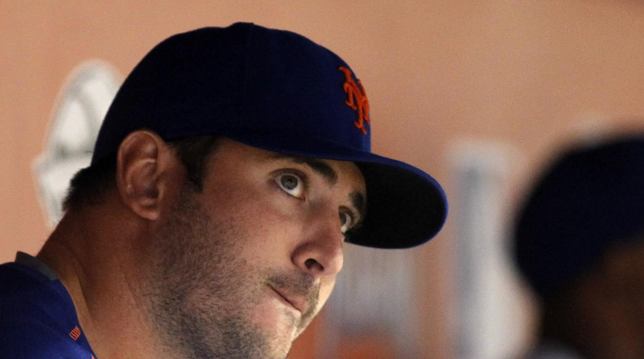 New York Mets pitcher Matt Harvey watches play from the dugout in the eighth inning of a baseball game against the Miami Marlins in Miami, Saturday, Sept. 5, 2015. (AP Photo/Joe Skipper)