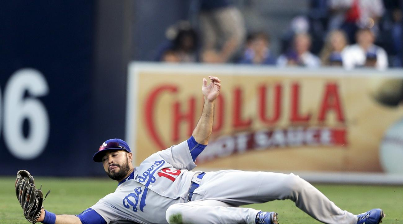 Los Angeles Dodgers right fielder Andre Ethier makes a catch for the out against San Diego Padres' Austin Hedges during the second inning of a baseball game Saturday, Sept. 5, 2015, in San Diego. (AP Photo/Gregory Bull)