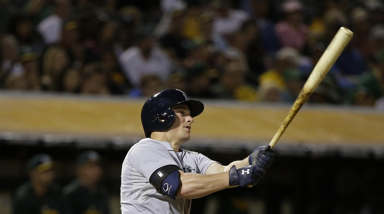 Seattle Mariners' Kyle Seager hits an RBI double off Oakland Athletics relief pitcher R.J. Alvarez in the eighth inning of their baseball game Saturday, Sept. 5, 2015, in Oakland, Calif. (AP Photo/Eric Risberg)