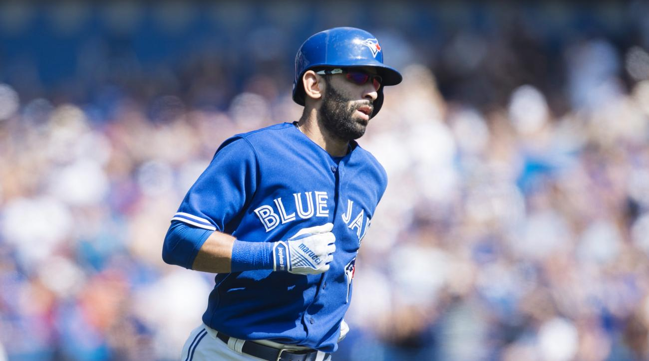 Toronto Blue Jays' Jose Bautista rounds the bases following a two-run home run during first inning MLB baseball action against the Baltimore Orioles in Toronto on Sunday, Sept. 6, 2015. (Darren Calabrese/The Canadian Press via AP)