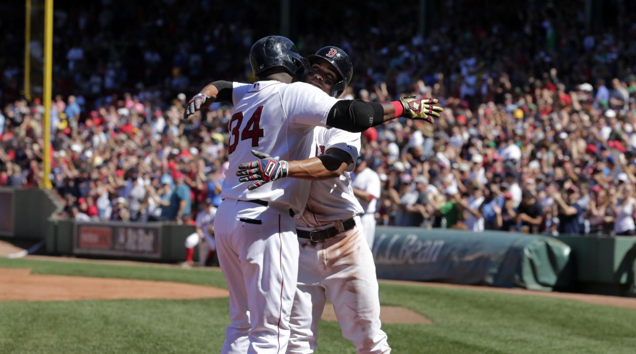 Boston Red Sox's David Ortiz, left, celebrates his home run with teammate Xander Bogaerts in the first inning of a baseball game against the Philadelphia Phillies, Sunday, Sept. 6, 2015, at Fenway Park, in Boston. (AP Photo/Steven Senne)