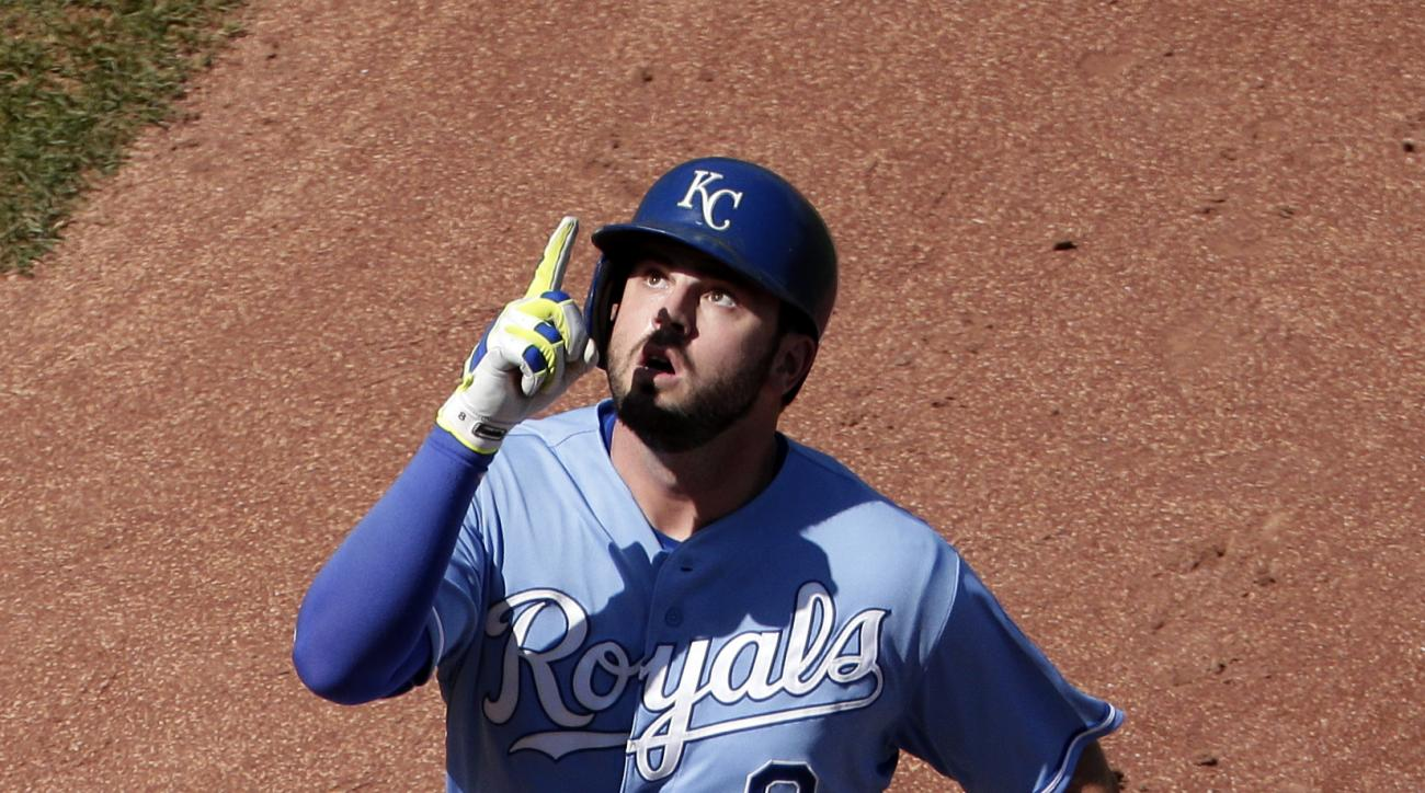 Kansas City Royals' Mike Moustakas celebrates as he crosses the plate after hitting a solo home run during the sixth inning of a baseball game against the Chicago White Sox, Sunday, Sept. 6, 2015, in Kansas City, Mo. (AP Photo/Charlie Riedel)