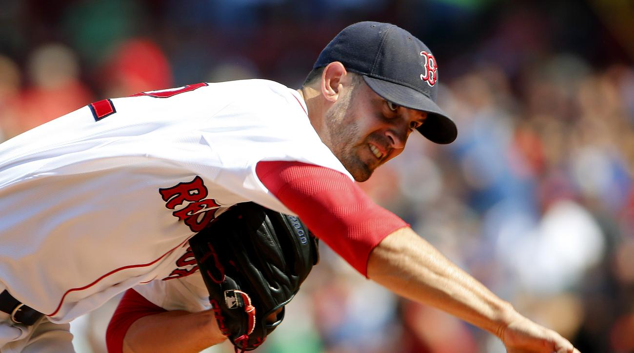 Boston Red Sox starting pitcher Rick Porcello delivers against the Toronto Blue Jays during the first inning of a baseball game at Fenway Park in Boston Monday, Sept. 7, 2015. (AP Photo/Winslow Townson)