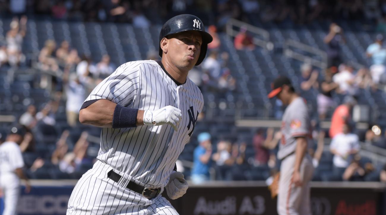 New York Yankees' Alex Rodriguez rounds the bases after hitting a home run against Baltimore Orioles pitcher Wei-Yin Chen, right, during the fifth inning of a baseball game Monday, Sept. 7, 2015, at Yankee Stadium in New York. (AP Photo/Bill Kostroun)