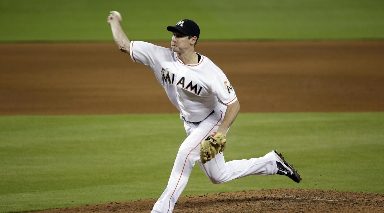 Miami Marlins' Brian Ellington delivers a pitch during the fifth inning of a baseball game against the Milwaukee Brewers, Monday, Sept. 7, 2015, in Miami. (AP Photo/Wilfredo Lee)