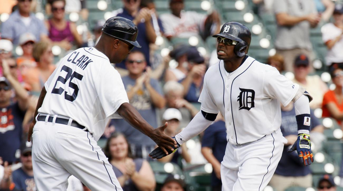 Detroit Tigers' Rajai Davis, right, is congratulated by third base coach Dave Clark  (25) after hitting a solo home run against the Tampa Bay Rays during the seventh inning of a baseball game at Comerica Park, Monday, Sept. 7, 2015, in Detroit. (AP Photo/