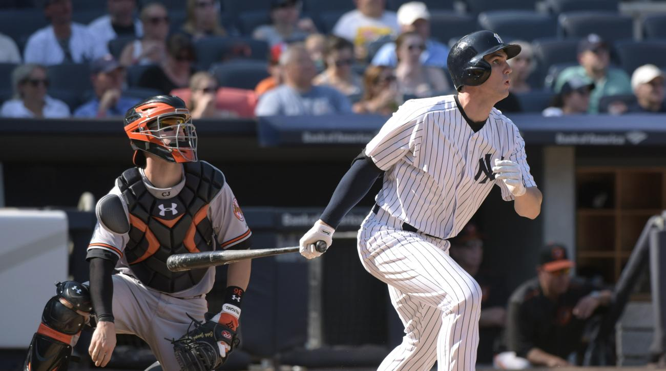 New York Yankees' Greg Bird, right, hits a three-run home run as Baltimore Orioles catcher Caleb Joseph, left, looks on during the seventh inning of a baseball game Monday, Sept. 7, 2015, at Yankee Stadium in New York. (AP Photo/Bill Kostroun)
