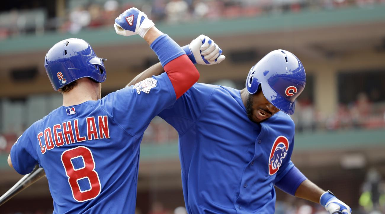 Chicago Cubs' Dexter Fowler, right, is congratulated by teammate Chris Coghlan after hitting a solo home run during the first inning of a baseball game against the St. Louis Cardinals Monday, Sept. 7, 2015, in St. Louis. (AP Photo/Jeff Roberson)
