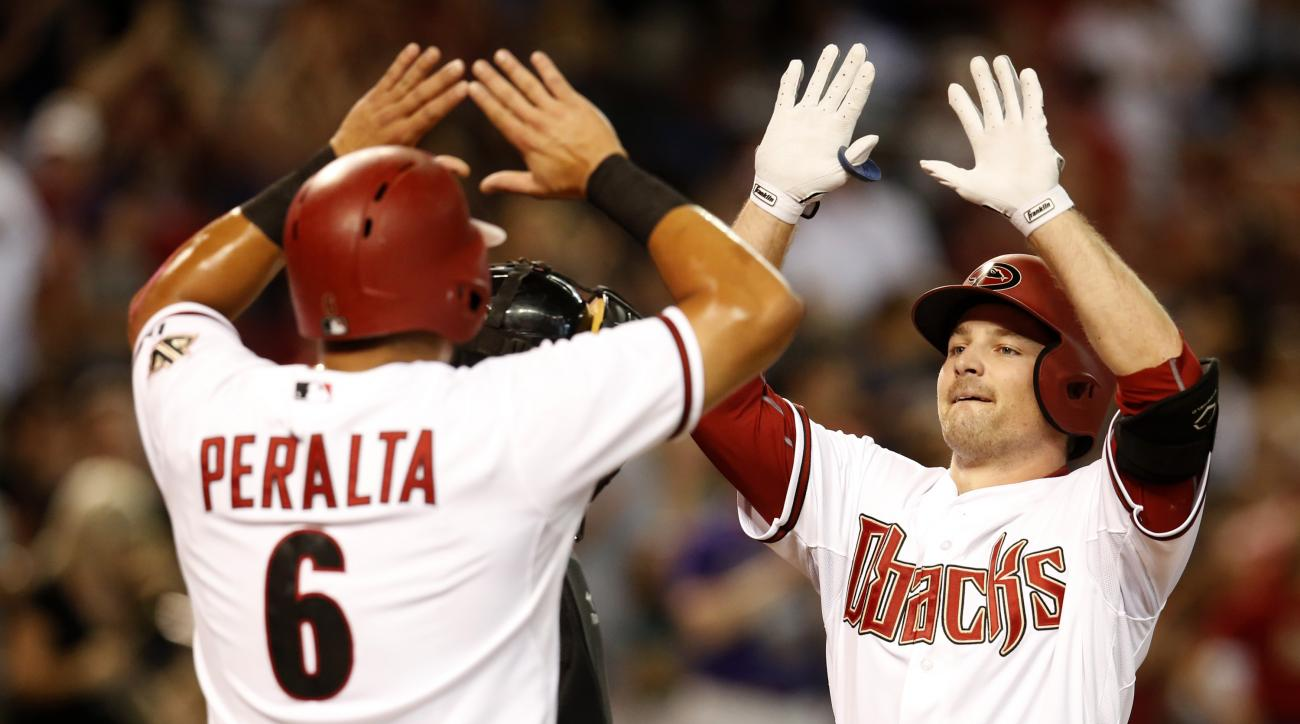 Arizona Diamondbacks Phil Gosselin celebrates with David Peralta (6) after hitting a three-run home run against the San Francisco Giants in the first inning during a baseball game Monday, Sept. 7, 2015, in Phoenix. (AP Photo/Rick Scuteri)