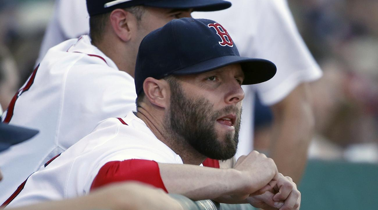 Boston Red Sox's Dustin Pedroia watches from the dug out during the sixth inning of a baseball game against the Philadelphia Phillies in Boston, Saturday, Sept. 5, 2015. (AP Photo/Michael Dwyer)