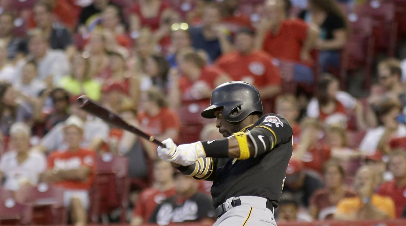 Pittsburgh Pirates Andrew McCutchen hits a three run home run off of Cincinnati Reds starting pitcher Raisel Iglesias during the third inning of a baseball game, Tuesday, Sept. 8, 2015, in Cincinnati. (AP Photo/Tony Tribble)