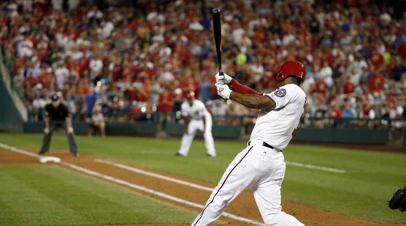 Washington Nationals' Michael Taylor (3) follows through on bases-loaded single during the sixth inning of a baseball game against the New York Mets at Nationals Park, Tuesday, Sept. 8, 2015, in Washington. Four runs scored. (AP Photo/Alex Brandon)