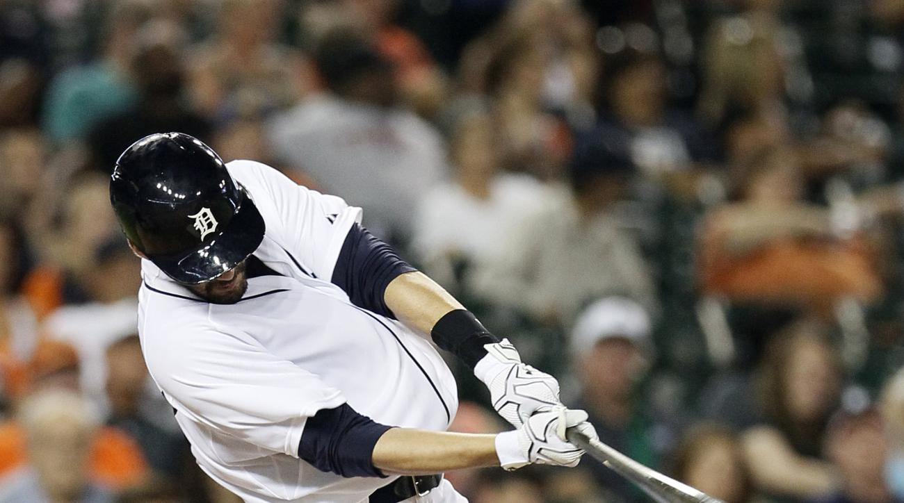 Detroit Tigers' J.D. Martinez hits a solo home run that broke a 6-6 tie during the eighth inning of a baseball game against the Tampa Bay Rays at Comerica Park Tuesday, Sept. 8, 2015, in Detroit. (AP Photo/Duane Burleson)