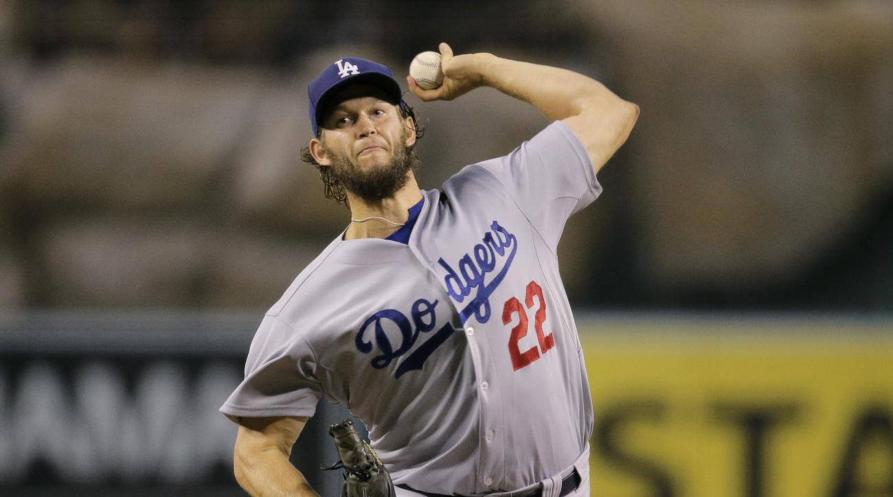 Los Angeles Dodgers starting pitcher Clayton Kershaw throws against the Los Angeles Angels during the first inning of a baseball game, Tuesday, Sept. 8, 2015, in Anaheim, Calif. (AP Photo/Jae C. Hong)