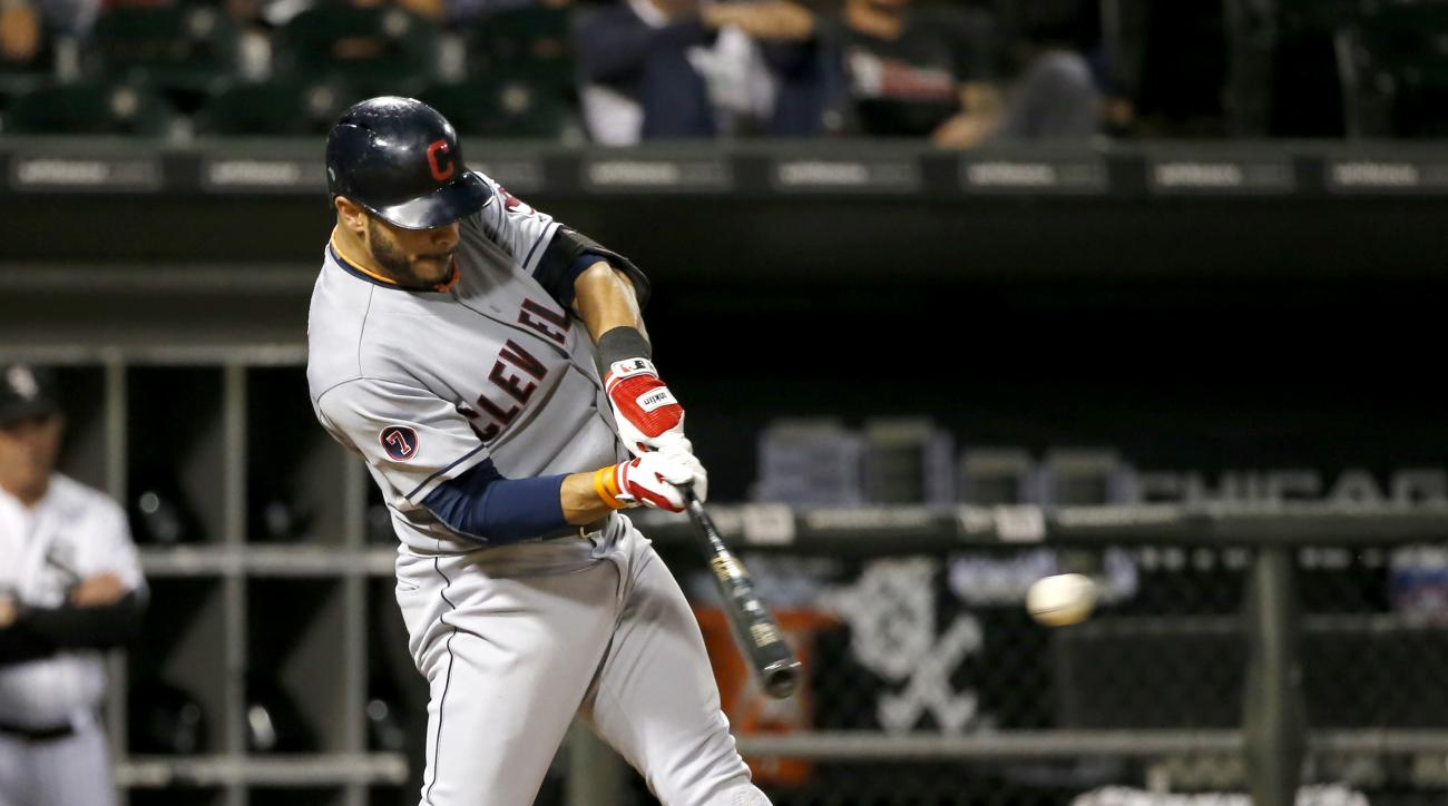 Cleveland Indians' Mike Aviles hits an RBI single off Chicago White Sox starting pitcher Carlos Rodon during the fifth inning of a baseball game Tuesday, Sept. 8, 2015, in Chicago. (AP Photo/Charles Rex Arbogast)