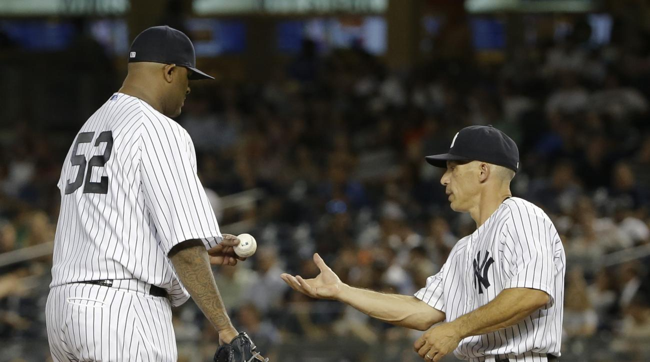 New York Yankees' CC Sabathia hands the ball to manager Joe Girardi as he leaves during the fifth inning of a baseball game against the Baltimore Orioles on Wednesday, Sept. 9, 2015, in New York. (AP Photo/Frank Franklin II)
