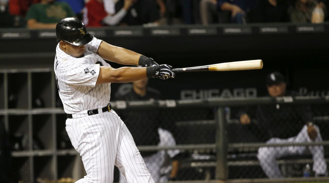 Chicago White Sox's Jose Abreu swings through a home run off Cleveland Indians starting pitcher Josh Tomlin during the sixth inning of a baseball game Wednesday, Sept. 9, 2015, in Chicago. (AP Photo/Charles Rex Arbogast)