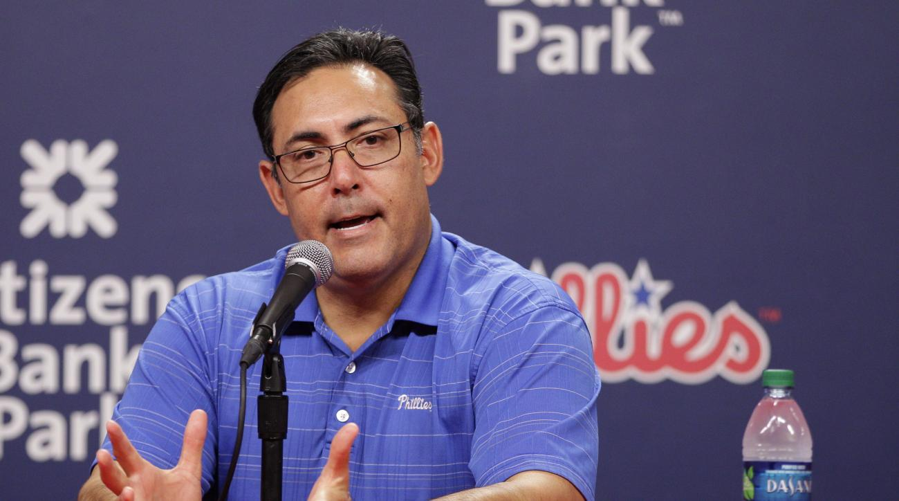 Philadelphia Phillies Senior Vice President & General Manager Ruben Amaro Jr. takes questions from the media after trading starting pitcher Cole Hamels  prior to the first inning of a baseball game against the Atlanta Braves, Friday, July 31, 2015, in Phi