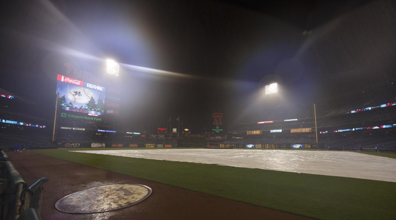 Rain falls on the field at Citizens Bank Park prior to a baseball game between the Chicago Cubs and the Philadelphia Phillies, Thursday, Sept. 10, 2015, in Philadelphia. The game was postponed until Friday due to the inclement weather. (AP Photo/Chris Sza