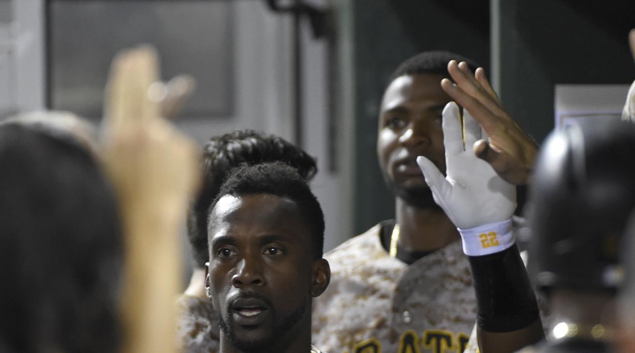 Pittsburgh Pirates' Andrew McCutchen is congratulated in the dugout after hitting a home run off Milwaukee Brewers pitcher Corey Knebel in the eighth inning of a baseball game, Thursday, Sept. 10, 2015, in Pittsburgh. (AP Photo/Fred Vuich)