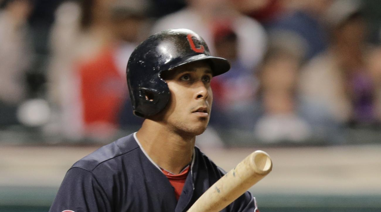 Cleveland Indians' Michael Brantley watches after hitting a two-run home run off Detroit Tigers relief pitcher Blaine Hardy in the eighth inning of a baseball game, Thursday, Sept. 10, 2015, in Cleveland. Indians' Francisco Lindor scored on the play. (AP