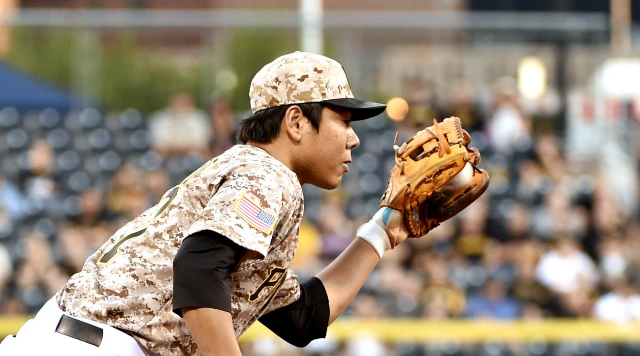 Pittsburgh Pirates' Jung Ho Kang fields a ball off the bat of Milwaukee Brewers' Domingo Santiago in the first inning of a baseball game, Thursday, Sept. 10, 2015, in Pittsburgh. (AP Photo/Fred Vuich)