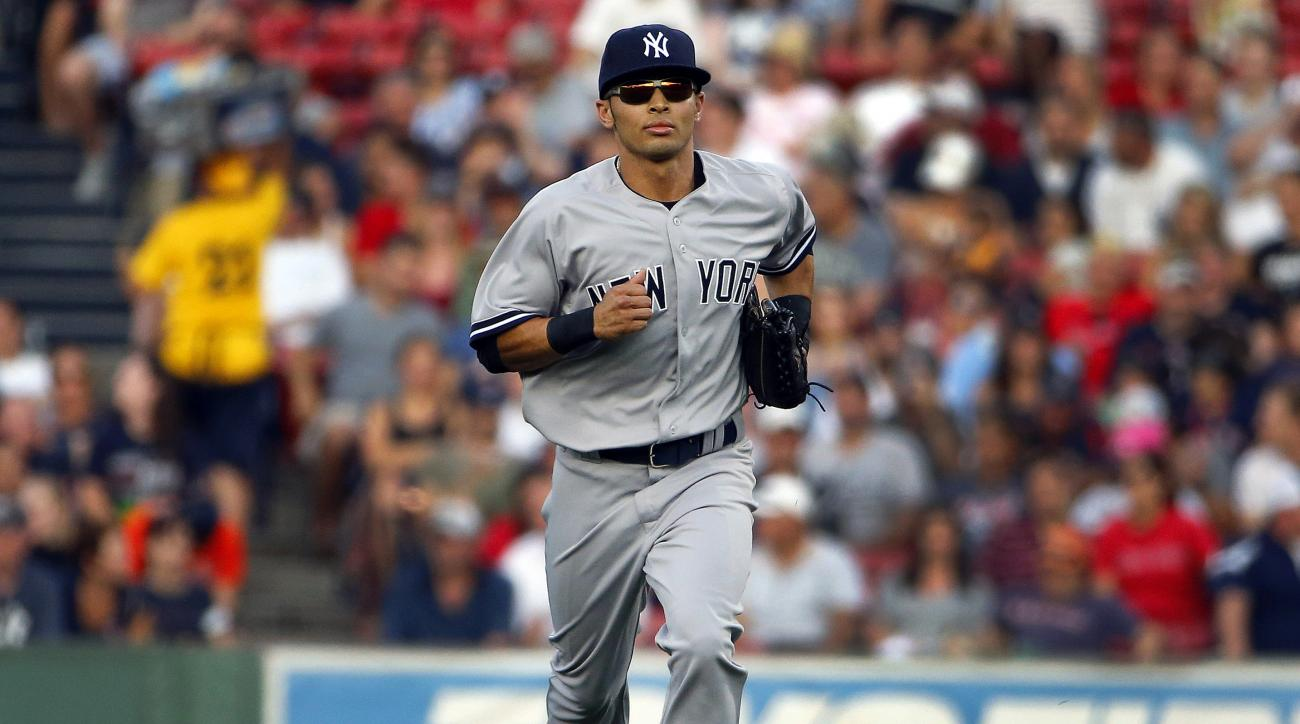 FILE- In this Sept. 2, 2015. file photo, New York Yankees center fielder Rico Noel jogs back to the dugout after the seventh inning of a baseball game against the Boston Red Sox at Fenway Park in Boston. Will the 26-year-old speedster, whose September rol