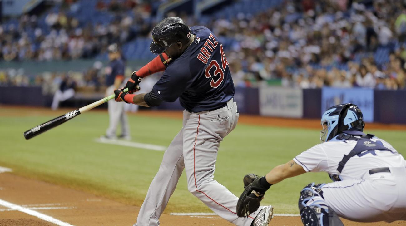 Boston Red Sox's David Ortiz (34) lines an RBI double off Tampa Bay Rays starting pitcher Chris Archer during the first inning of a baseball game Friday, Sept. 11, 2015, in St. Petersburg, Fla. Xander Bogaerts scored. Catching for the Rays is Rene Rivera.