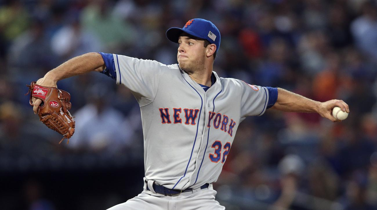 New York Mets starting pitcher Steven Matz (32) works during the first inning of a baseball game against the Atlanta Braves on Friday, Sept. 11, 2015, in Atlanta. (AP Photo/John Bazemore)