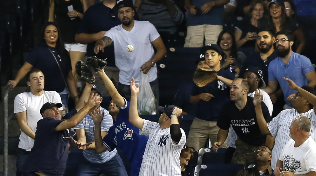New York Yankees' Carlos Beltran (36) can't reach a two-run home run by Toronto Blue Jays' Justin Smoak during the first inning of a baseball game at Yankee Stadium in New York, Friday, Sept. 11, 2015. (AP Photo/Kathy Willens)