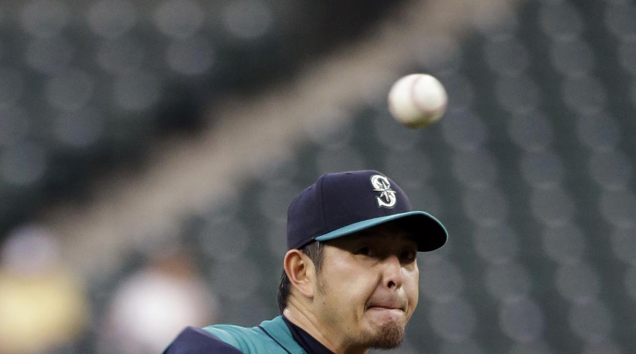 Seattle Mariners starting pitcher Hisashi Iwakuma throws against the Colorado Rockies during the first inning of a baseball game Friday, Sept. 11, 2015, in Seattle. (AP Photo/Elaine Thompson)