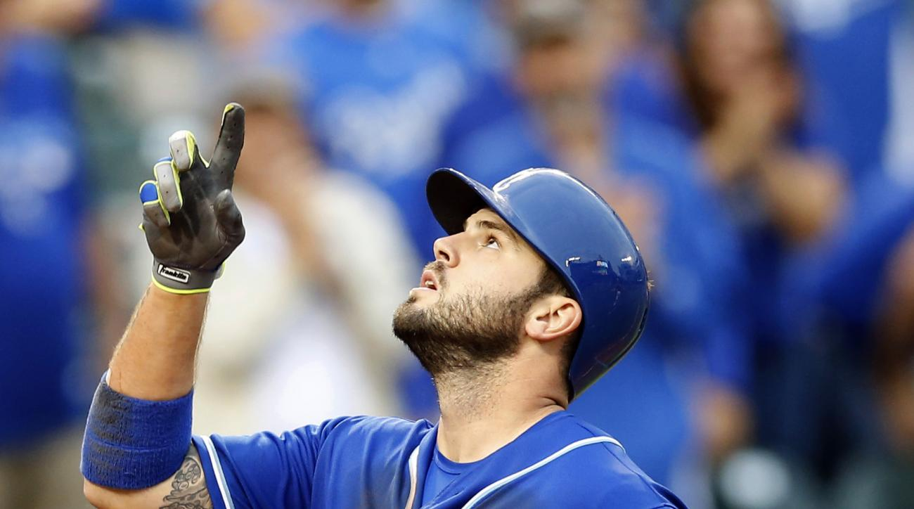 Kansas City Royals' Mike Moustakas gestures as he crosses home plate after hitting a grand slam in the seventh inning of a baseball game against the Baltimore Orioles, Saturday, Sept. 12, 2015, in Baltimore. (AP Photo/Patrick Semansky)