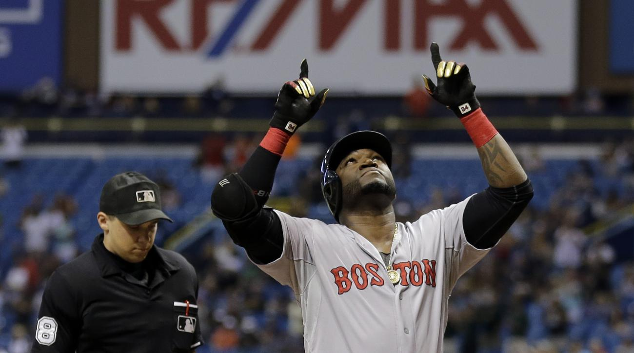 Boston Red Sox's David Ortiz reacts after hitting his 500th career home run off Tampa Bay Rays starting pitcher Matt Moore during the fifth inning of a baseball game Saturday, Sept. 12, 2015, in St. Petersburg, Fla.  looking on is home plate umpire Adam H